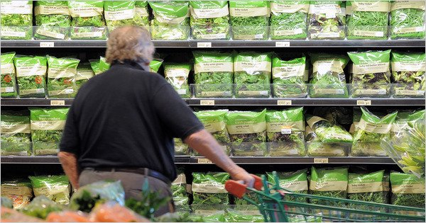 man buying lettuce